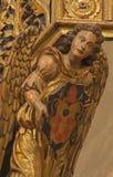ZARAGOZA, SPAIN, 2018: The polychome carved detai of angel on the amin altar in church Iglesia de San Miguel de los Navarros. ZARAGOZA, SPAIN - MARCH 3, 2018 royalty free stock photography