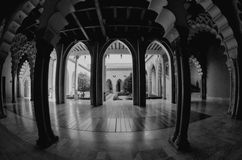 Zaragoza, Spain - September 14, 2015: Aljaferia Palace hall with arches. Black and white color. Touristic landmark. Zaragoza, Spain - September 14, 2015 royalty free stock images