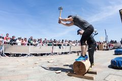 Zarautz, Gipuzcoa / Spain - May 12 2019: Wood chopping demostration in basque country royalty free stock photography