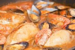 Zarzuela of fish. And mussels stuffed calamari with sauce Stock Photography