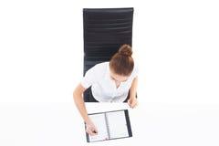 Zasięrzutny widok młody, ufny bizneswoman z organizatorem, Fotografia Stock
