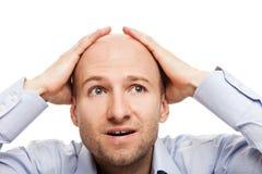 zaskakujący zadziwiający łysy głowiasty mężczyzna Zdjęcia Royalty Free