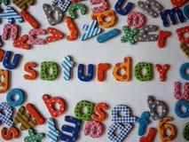 Zaterdagbanner met kleurrijke kleine letters stock foto