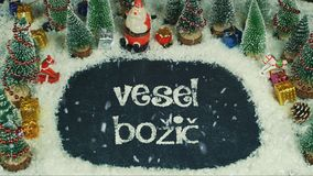 Zatrzymuje ruch animację Vesel BoÅ ¾ iÄ  slowen w Angielskich Wesoło bożych narodzeniach, zdjęcie stock