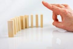 Zatrzymywać domino skutek Zdjęcie Stock