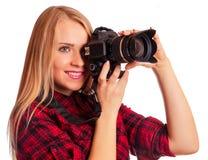 Zauberamateurphotograph, der eine Berufskamera hält Lizenzfreies Stockfoto