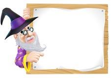 Zauberer, der auf Zeichen zeigt Stockfotografie