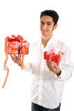 Zaubermann mit Geschenk. Stockfotografie