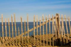Zaun auf dem Strand Stockfoto