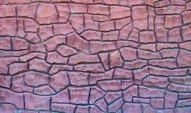 Zaun hergestellt vom roten Stein, Beschaffenheit, Hintergrund Lizenzfreies Stockfoto