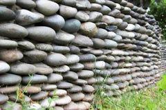 Zaun hergestellt von den Steinen Stockbilder
