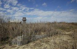 Zaun im Sand auf Strand Lizenzfreie Stockfotografie
