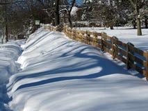 Zaun im Schnee Stockbilder