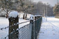 Zaun im Winter Stockbild