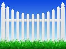 Zaun mit Gras Stockfoto