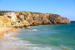 Zavial beach in Portugal with lot of surfers in ocean Royalty Free Stock Images