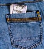 Zawaleni dolary w twój kieszeni Obraz Stock