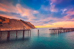 Zawalony jetty przy gwałtowny zatoką, Południowy Australia Zdjęcie Stock