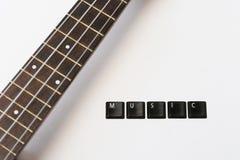 Zawiązuje ukulele muzyki tło fotografia royalty free
