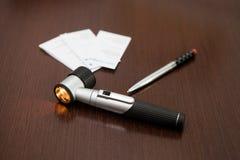 Zawierać Dermatoscope na stole Zdjęcie Royalty Free