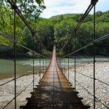 Zawieszenie most przez rzeki zdjęcie stock
