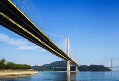 Zawieszenie most w Hong Kong przy dnia czasem fotografia royalty free