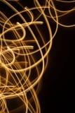 Zawijas błyska jarzący się linii tło Fotografia Stock