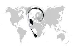 Zawody międzynarodowi kontaktowy pojęcie, odgórnego widoku biurko z słuchawki i m, fotografia stock