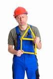 Zawodzący pracownik z miara domem Obraz Royalty Free