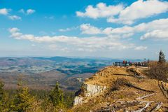 Hikers travel in the Babia Gora Mountain with a backpack. Zawoja, Poland - May 03, 2015: Hikers travel in the Babia Gora Mountain with a backpack Stock Photo