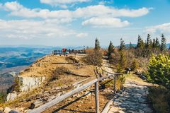 Hikers travel in the Babia Gora Mountain with a backpack. Zawoja, Poland - May 03, 2015: Hikers travel in the Babia Gora Mountain with a backpack Royalty Free Stock Image