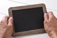 Zbliżenia Chalkboard i ręki Zdjęcie Stock