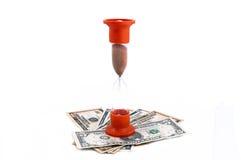 zbliżenia pojęcia szklany pieniądze piaska czas Zdjęcie Stock