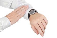 zbliżenia ręki odizolowywający mężczyzna zegarek fotografia stock