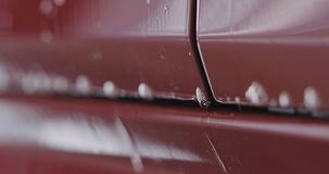 Zbliżenia samochodowego obmycia szamponu czerwony namok fotografia royalty free