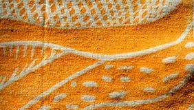 Zbliżenie żółta blokowego druku sztuka na tkaninie Zdjęcia Royalty Free