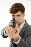 Zbliżenie młody człowiek z pistoletem Zdjęcia Royalty Free
