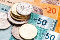 Zbliżenie Malezja Ringgit waluta zauważa i monety Zdjęcia Stock
