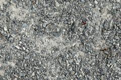 Zbliżenie popielaci kamienie i żwir na przejściu Zdjęcia Stock