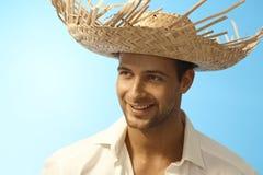 Zbliżenie portret młody człowiek w słomianym kapeluszu Zdjęcia Stock