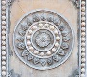 Zbliżenie symbol buddyzm, Rowel stiuk w świątyni Obraz Stock