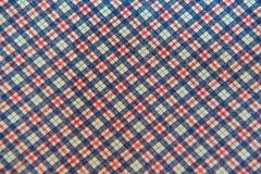 Zbliżenie szkockiej kraty tkaniny Biała błękitna czerwień dla tła Fotografia Stock