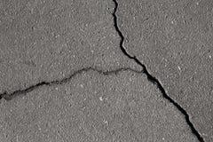 Zbliżenie tekstura uszkadzająca asfaltowa droga Fotografia Royalty Free