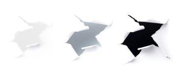 Zbliżenie zmroku dziury na biały papierze zdjęcie stock