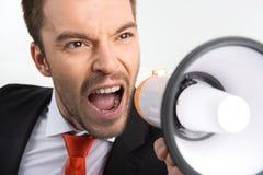 Zbliżenie na twarzy biznesmena mienia megafon Zdjęcia Stock