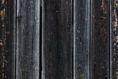 Zbliżenie strzał czerń burnt na krawędzi drewnianych deskach Fotografia Royalty Free