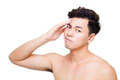 Zbliżenie wprawiać w zakłopotanie młody człowiek twarz Fotografia Stock