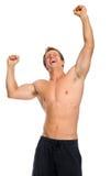 zbroi atlety excited podwyżki jego zwycięstwo Zdjęcia Stock
