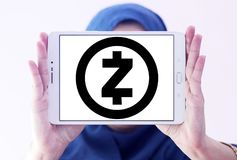 Zcash cryptocurrency logo. Logo of Zcash cryptocurrency on samsung tablet holded by arab muslim woman. Zcash is a cryptocurrency that grew out of the Zerocoin royalty free stock image