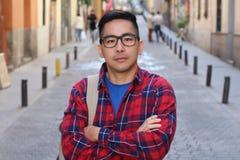 Zdecydowany Azjatycki mężczyzna z rękami krzyżować obraz royalty free